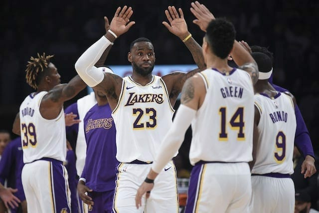 Los Angeles Lakers teammates Danny Green, Dwight Howard, LeBron James and Rajon Rondo celebrate