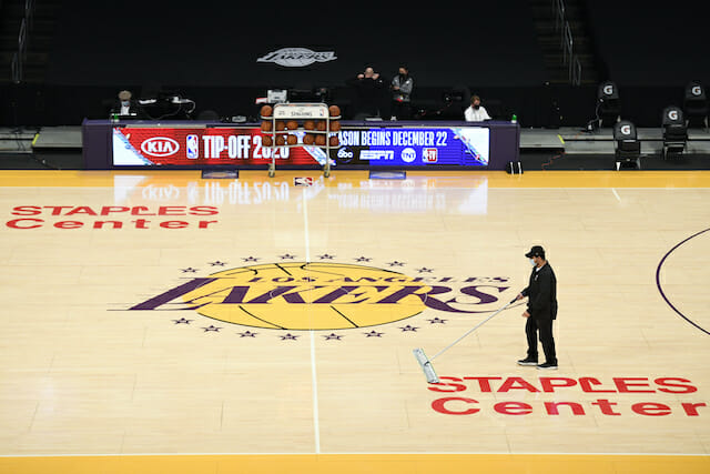 Lakers logo, Staples Center court view, mopping floor